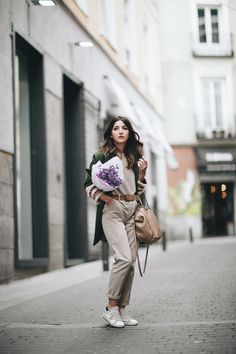 CASUAL MONDAY - Lovely Pepa by Alexandra. Beige sweater+beige pants+white and beige sneakers+brown belt+camel studded shoulder bag+green coat with ethinc details. Winter Casual Outfit 2017