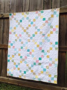 Single Irish Chain quilt in turquoise, yellow, pink 1930s repro prints, crib size - custom for Heather, Florida, August 2014  www.etsy.com/shop/thedandypatch
