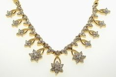 2.00CTW ROUND DIAMOND LADIES FLOWER NECKLACE     Metal Type - 14KYG     Metal Weight (gms) - 18.78 (approx.)     GD-22812    www.thesgdex.com
