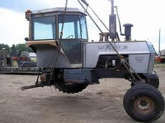 White 2-105 tractor salvaged for used parts. This unit is available at All States Ag Parts in Salem, SD. Call 877-530-4010 parts. Unit ID#: EQ-24511. The photo depicts the equipment in the condition it arrived at our salvage yard. Parts shown may or may not still be available. http://www.TractorPartsASAP.com