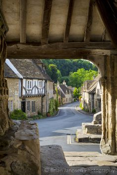 View through Market Cross Monument in Castle Combe, the Cotswolds, Wiltshire, England. © Brian Jannsen Photography