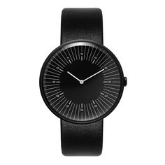 Nomad Outline Black Watch: The Line timepieces are designed to act as precise tools for measuring time while retaining a playful edge. Each face features typical numerical, minute and hour markings but re-arranged in new compositions to add a fresh contemporary look.   The Outline combines the hour markings and all 12 numbers away from the edge of the dial, setting them within an array of elongated minute increments.   A textured steel case, mimicking cast iron, injects a subtle element of…