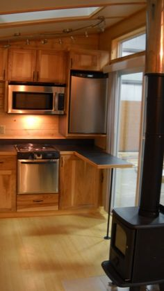 This portable small home on wheels is 8′ x 22′ 176 sq. ft. without including any upstairs sleeping loft space. | Tiny Homes
