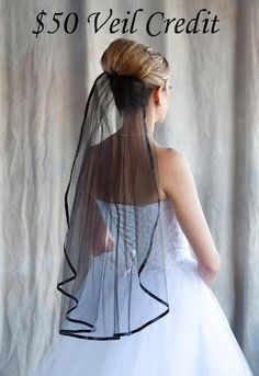 Simple stunning and elegant...this black veil could be just the point of difference you are looking for...by http://www.facebook.com/pages/Gothic-Weddings/231732613532204  and take a close look at the back of the dress....gorgeous...