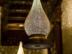 Love the intricate punched pattern in this brass lampshade which casts a beautiful glow on surrounding walls. Mamounia chandelier via Casbah Decor