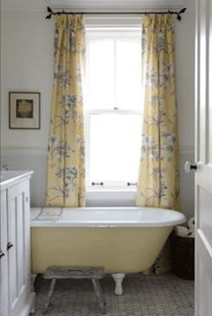 yellow and grey bathroom with antique tub