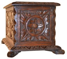 19th-century English oak box in the form of a blanket chest. Hand-carved decoration on three sides, lovely molded edges, and raised scroll feet.