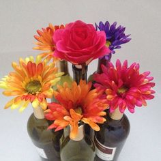 Flower bottle stoppers that double as a festive bouquet.
