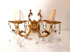 Pair of bronze French Wall Sconces cut Crystal droplets. French Vintage. Tipical apartement parisienne sconces. With 9 crystal drops each candelabra  Bright and elegant