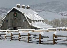 Pretty snow surrounded all around a barn!