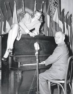 FILE: That's Lauren Bacall perched atop a piano being played by Vice President Harry Truman at the press club in Washington.