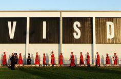 Members of the Victoria East High School class of 2013 walk toward Memorial Stadium for the graduation ceremony. More than 300 graduates walked the stage to receive diplomas Friday night. Photo by Angeli Wright