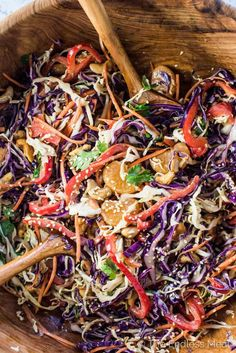 This colorful and delicious Asian Coleslaw Recipe makes the perfect side to any BBQ. It's loaded with crunchy veggies, sweet mandarin oranges, androasted cashews and tossed in a (mayo-free!) creamy orange sesame dressing. You will LOVE it! | vegan + paleo + gluten-free |