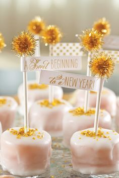 Tiny sweets are a mini celebration on their own with gold pom-poms attached to lollypop sticks and finished with a tag
