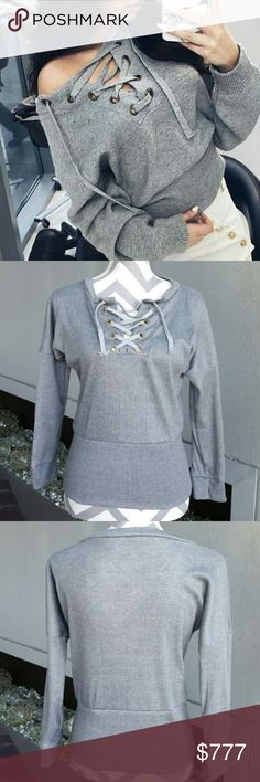 "SASSY GRAY LACE UP FRONT TOP. Brand new  Boutique item   Gray lace up front ribbed top! Pair will ripped up jeans and booties for a complete look.   Medium: Bust 18""/length 22.5""  Large: 19""across/length 23.5""  Please double check measurements before purchase  No material tag, Brand new, from manufacturer. Pic 2,3, irl . Tops"