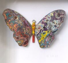 Urban butterfly reflects the state of our society. A waste to art project using recycled graffiti and wooden dolls