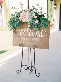 Rustic eucalyptus and peony topped wedding sign