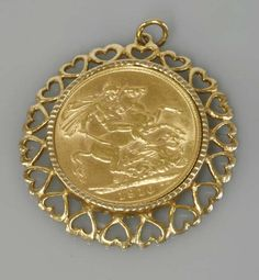 A sovereign dated 1910, in a 9ct gold pendant mount with a pierced heart border. Sold for £240