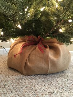 Wrap a pool noodle along your Christmas Tree stand, wrap it in burlap and secure it with a ribbon. Instant rootball!
