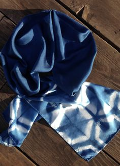 Hexagon-edged silk charmeuse scarf. Cool and luxurious to the touch. Hexagonal shibori shapes are at the edges of a deep indigo scarf, catching the light at different angles. Lovingly hand-dyed in the