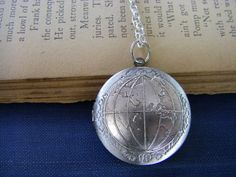 Such a beautiful piece...I may have it for myself: Silver World Globe Traveler Locket Necklace by CHAiNGEthesubject, Etsy