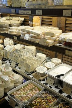 French cheeses at a market.  Paris, France