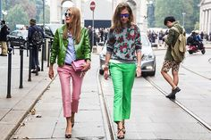 Anna Del Russo and her colour blocking friend just rock those bright green hues and cigarette trousers (topshop tumblr)