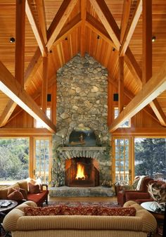 A massive fireplace easily becomes the focal point of a room, trimmed with stone and exposed beams.
