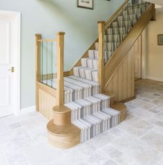 This oak staircase with glass spindles has transformed the staircase into a focal point. Special features include bespoke oak cladding and newel posts. Loft Staircase, Stair Banister, Banisters, Railings, Oak Stairs, Entry Stairs, House Stairs, Home Stairs Design, House Design