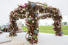 Chuppah with Colorful Hydrangeas    Photography: Sheri Whitko   Read More:  http://www.insideweddings.com/weddings/jewish-wedding-with-personal-details-and-a-whimsical-garden-motif/808/