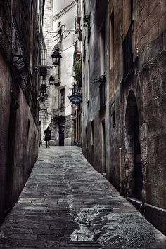 Urban Photography Theme: Back Alley - Man and Dog on Alley, Barri Gotic, Barcelona by Carlos Lorenzo