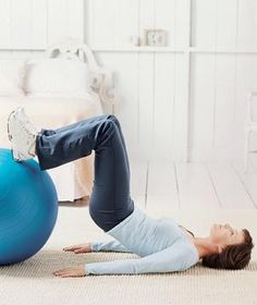 The Rolling Reverse Plank fitness ball workout move works the abs, buttocks, back, and thighs.