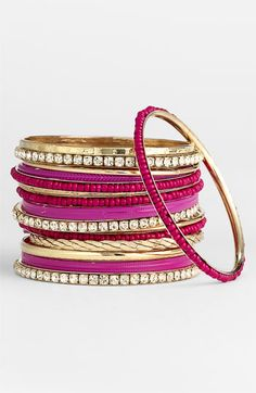 Fucshia/gold mixed media bangles are sure to add a pop to any outfit.