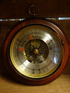 "Hanging Fischer barometer from the 1960s. Manufactured in E Germany and sold at Neiman Marcus. Original tag on back.  Measures 7"" in diameter."