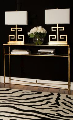 Gold, Black and White Foyer Elegance Elegant foyer with dramatic elements: Zebra print rug, gold table and lamps and black walls! Design Entrée, Deco Design, Design Trends, Lobby Design, Design Model, Foyer Decorating, Interior Decorating, Decorating Ideas, Decorating Bookshelves