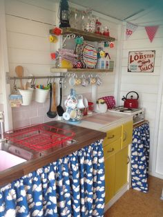 Inside of our much-loved beach hut! Clouds, pink metro tiles and pops of bright yellow make it our haven by the sea. Front-row location - you can even hire it! Boho Kitchen, Cute Kitchen, Farmhouse Kitchen Decor, Vintage Kitchen, Happy Kitchen, Beach Hut Interior, Shed Interior, Cubby Houses, Play Houses