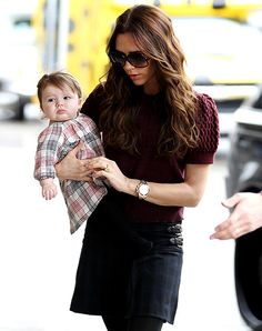 I personally think Victoria Beckham is one of the most beautiful moms on the planet. And that plaid dress is precious!