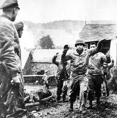 Officers of the 1st SS Panzer Division look at the prisoners of the US 30th Infantry Division in Stoumont. #WW2