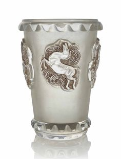 A Camargue Vase, No. 10-937 designed 1942, executed early post-war, clear, frosted and sepia stained  11 ¼ in. (28.6 cm.) high  stencilled LALIQUE FRANCE