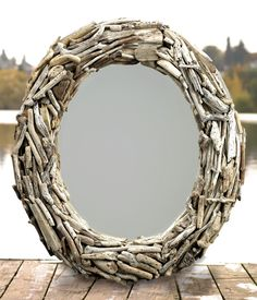 Large oval driftwood mirror.