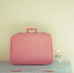 Oh how I wish the thrift stores  would smile on me and allow me to find a pretty pink retro suitcase like this one day.