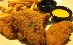 CHICKEN FINGERS TGI Friday's Copycat Recipe Serves 6 1 package Chicken Breasts, Cut Into Strips Buttermilk 1-1/2 cup Flo...