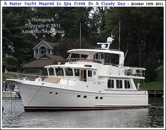 A motor yacht moored on Spa Creek in Annapolis Maryland one overcast Autumn morning. Photograph taken on October 19th 2011. To see a full size version of this photograph, as well as the accompanying Annapolis Experience Blog article, please click through on the Pinterest images for it. Copyright © 2012 Annapolis Experience