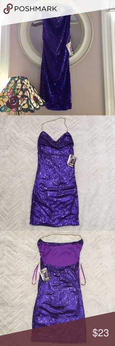 """NWT Sexy Purple Sequins Party Dress NEW w/TAGS Sz Med Purple Sequins Dress by Dreamgirl. Sizes 4-6 would be ideal for this dress. Has stretch & adjustable halter chain. 30"""" Length. Retails at $43. Figure flattering. Please see ALL photos. I bought it a while back but it's just hanging in my closet. So I'm passing it on to my fellow Poshers! From smoke free & pet free home. BUNDLE AND SAVE! I Welcome All Offers. 😊 Dreamgirl Dresses Mini"""