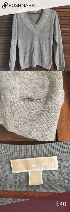 FINAL Michael Kors Rhinestone Sweater EUC  no trades  EUC. Size S. Worn, washed and air dried once. Lightweight sweater! Full length sleeves, v-neck pullover. Shiny rhinestones on front. Silver MK bar logo on bottom left. (As pictured). No stains, pills, runs, or tears.  Michael Kors Tops