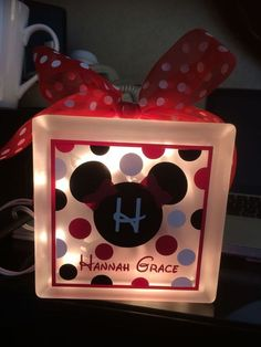 Glass Block with interior lights and ribbon.  Choice of painted or custom vinyl tie Disney design with customized name.