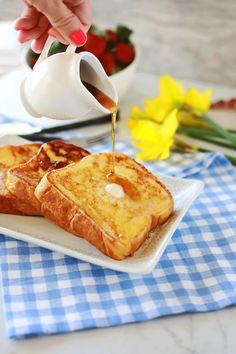 Bread dipped in a cream, eggs & spices batter made thick with a special technique, then cooked to perfection. Easy fast recipe for amazing French Toast!