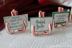 What an adorable and easy idea ... simply glue (or tie with a ribbon)  three mini-candy-canes together to form a stand, and add your buffet cards or table place cards! ♥ (As seen on @Christie Moffatt nolen Sisters Facebook page.)