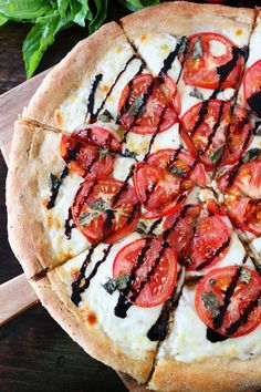 Caprese Pizza Recipe. Ingredients: pizza dough; mozzarella; 2 large ripe tomatoes; fresh basil; Balsamic Glaze (1 cup balsamic vinegar reduced)