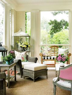 Bold floral patterns are a stylish addition to this garden-inspired porch. More outdoor porch ideas: http://www.bhg.com/home-improvement/porch/porch/outdoor-porch-design-and-decorating/?socsrc=bhgpin051413gardenpatio=2